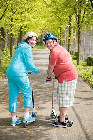 fat man exercising - Couple riding scooters Stock Photo - Premium Royalty-Free, Code: 673-02142525