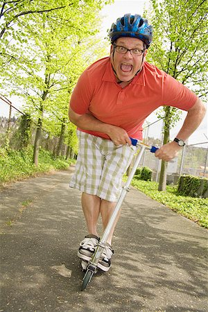 fat man exercising - Man riding a scooter Stock Photo - Premium Royalty-Free, Code: 673-02142526