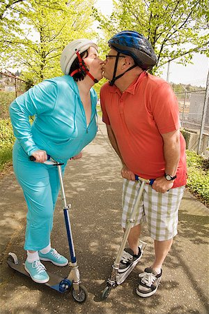 fat man exercising - Couple riding scooters Stock Photo - Premium Royalty-Free, Code: 673-02142528