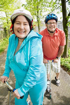 Couple riding scooters together Stock Photo - Premium Royalty-Free, Code: 673-02142547