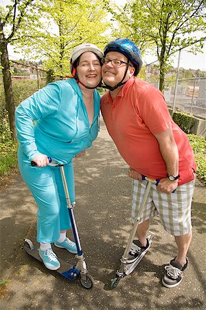 fat man exercising - Couple riding scooters together Stock Photo - Premium Royalty-Free, Code: 673-02142548