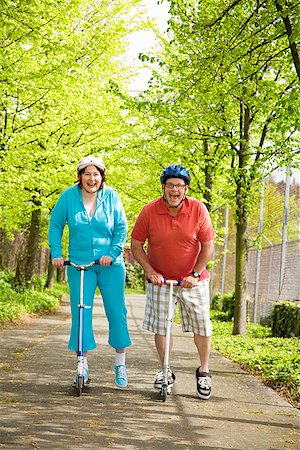 Couple riding scooters together Stock Photo - Premium Royalty-Free, Code: 673-02142543