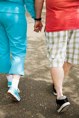 fat man exercising - Couple walking together outside Stock Photo - Premium Royalty-Free, Code: 673-02142554