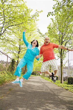 Couple jumping for joy outside Stock Photo - Premium Royalty-Free, Code: 673-02142556