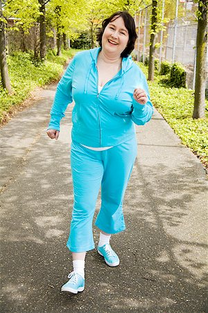 Woman power walking outdoors Stock Photo - Premium Royalty-Free, Code: 673-02142550
