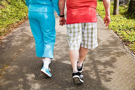 fat man exercising - Couple walking together outside Stock Photo - Premium Royalty-Free, Code: 673-02142552