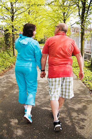 fat man exercising - Couple walking together outside Stock Photo - Premium Royalty-Free, Code: 673-02142553
