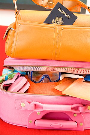 Packed suitcase and purse Stock Photo - Premium Royalty-Free, Code: 673-02142766