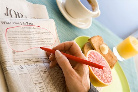 Circled classified ad next to breakfast Stock Photo - Premium Royalty-Free, Code: 673-02142779
