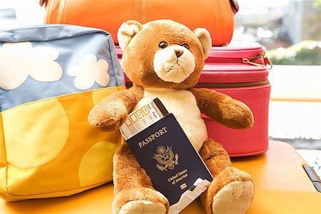 Teddy bear holding passport Stock Photo - Premium Royalty-Free, Code: 673-02142771