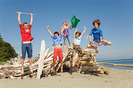 Group of children jumping at beach Stock Photo - Premium Royalty-Free, Code: 673-02142810