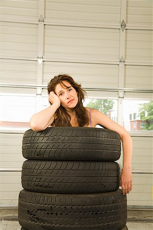 Nude woman standing in stack of tires Stock Photo - Premium Royalty-Free, Code: 673-02142841
