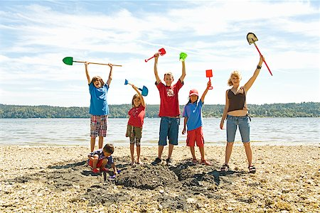 simsearch:400-04222950,k - Group of children cheering at beach Stock Photo - Premium Royalty-Free, Code: 673-02142928