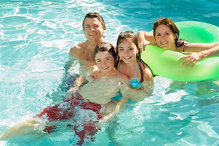 preteen girl wet clothes - Family in swimming pool Stock Photo - Premium Royalty-Free, Code: 673-02143074