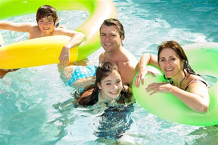 preteen girl wet clothes - Family in swimming pool Stock Photo - Premium Royalty-Free, Code: 673-02143073