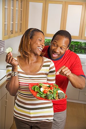 African couple with vegetable plate in kitchen Stock Photo - Premium Royalty-Free, Code: 673-02143107