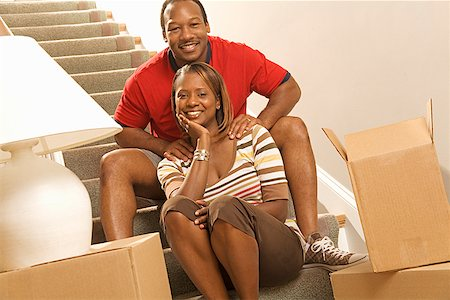 African couple next to moving boxes Stock Photo - Premium Royalty-Free, Code: 673-02143125