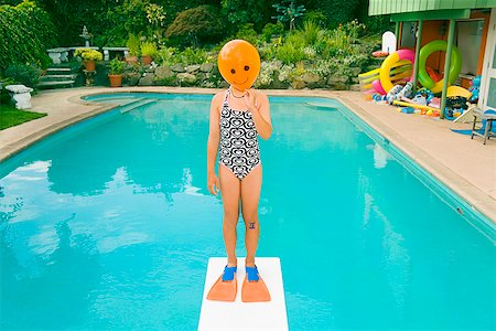 Girl with balloon in front of face over swimming pool Stock Photo - Premium Royalty-Free, Code: 673-02143228
