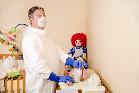 smelly - Father in decontamination suit changing baby's diaper Stock Photo - Premium Royalty-Free, Code: 673-02143243