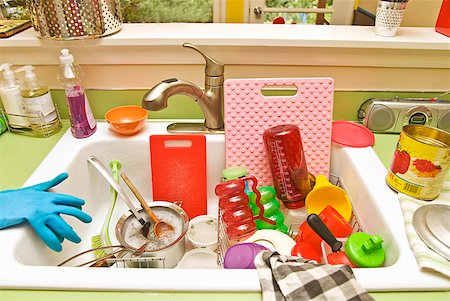 Sink filled with dirty dishes Stock Photo - Premium Royalty-Free, Code: 673-02143475