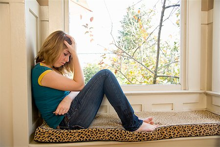 sad girls - Teenaged girl sitting next to window Stock Photo - Premium Royalty-Free, Code: 673-02143590