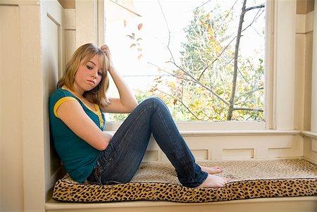 sad girls - Teenaged girl sitting next to window Stock Photo - Premium Royalty-Free, Code: 673-02143592