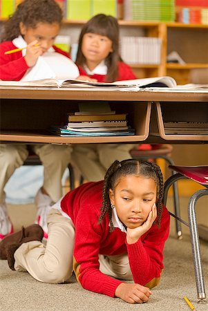 photo of class with misbehaving kids - African girl sitting under school desk Stock Photo - Premium Royalty-Free, Code: 673-02143655