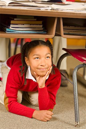 photo of class with misbehaving kids - African girl sitting under school desk Stock Photo - Premium Royalty-Free, Code: 673-02143684