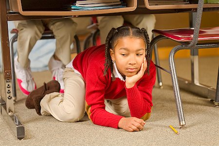 photo of class with misbehaving kids - African girl sitting under school desk Stock Photo - Premium Royalty-Free, Code: 673-02143685