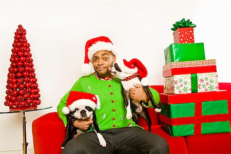 Black People Decorating For Christmas pictures of black people decorating a christmas tree stock photos