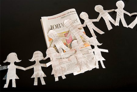 Paper dolls and employment section of newspaper Stock Photo - Premium Royalty-Free, Code: 673-02216494