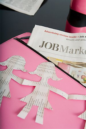 Paper dolls, briefcase and employment section of newspaper Stock Photo - Premium Royalty-Free, Code: 673-02216496