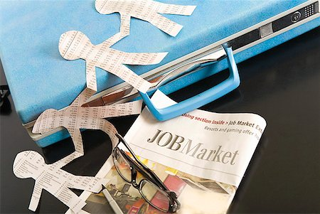Paper dolls, briefcase and employment section of newspaper Stock Photo - Premium Royalty-Free, Code: 673-02216503