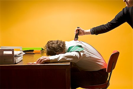 dead female body - Man in office being stabbed in the back Stock Photo - Premium Royalty-Free, Code: 673-02801404
