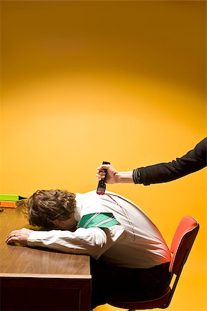dead female body - Man in office being stabbed in the back Stock Photo - Premium Royalty-Free, Code: 673-02801405