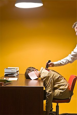 dead female body - Woman in office being stabbed in the back Stock Photo - Premium Royalty-Free, Code: 673-02801409