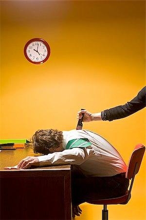 dead female body - Man in office being stabbed in the back Stock Photo - Premium Royalty-Free, Code: 673-02801403