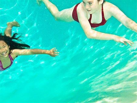 Two girls swimming under water Stock Photo - Premium Royalty-Free, Code: 673-03005624