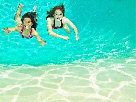 Two girls swimming under water Stock Photo - Premium Royalty-Free, Code: 673-03005625