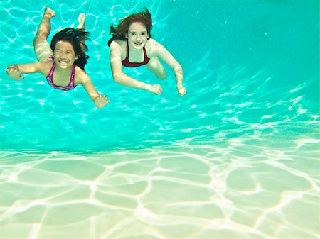 Two girls swimming under water Stock Photo - Premium Royalty-Free, Code: 673-03005625