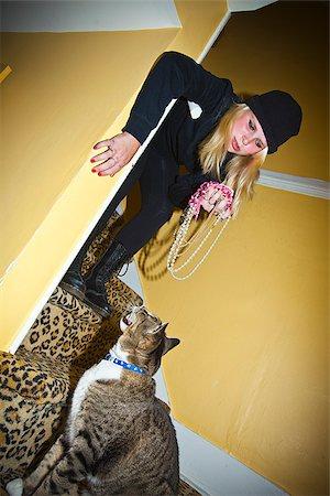 preteen girl pussy - Teen girl dressed as cat burgler Stock Photo - Premium Royalty-Free, Code: 673-03005691