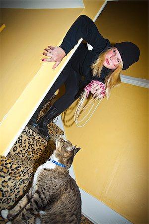 preteen girl pussy - Teen girl dressed as cat burgler Stock Photo - Premium Royalty-Free, Code: 673-03005692