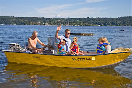 men and young children on motorboat ride Stock Photo - Premium Royalty-Free, Code: 673-03405797