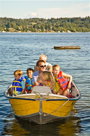 men and young children on motorboat ride Stock Photo - Premium Royalty-Free, Code: 673-03405799