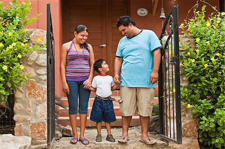 portrait of young mexican family Stock Photo - Premium Royalty-Free, Code: 673-03623224