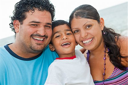 portrait of young mexican family Stock Photo - Premium Royalty-Free, Code: 673-03623237