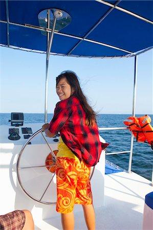 teen girl steering yacht Stock Photo - Premium Royalty-Free, Code: 673-03826260