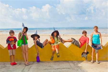 children at beach in witch hats Stock Photo - Premium Royalty-Free, Code: 673-03826275