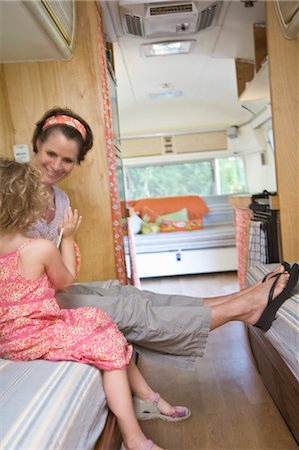 woman and girl seated inside camper Stock Photo - Premium Royalty-Free, Code: 673-03826304