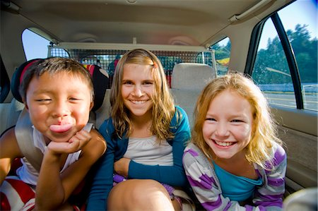 preteen girls faces photo - children making faces in car Stock Photo - Premium Royalty-Free, Code: 673-03826309